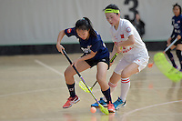 Malaysia's Katelyn Ch'ng Ci Ern and China's Xiaohong Zhang in action during the World Floorball Championships 2017 Qualification for Asia Oceania Region - Malaysia v China at ASB Sports Centre , Wellington, New Zealand on Sunday 5 February 2017.<br /> Photo by Masanori Udagawa<br /> www.photowellington.photoshelter.com.