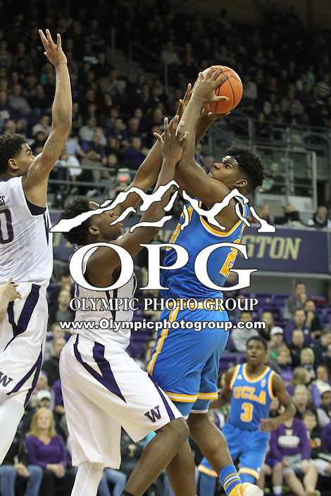 JAN 1, 2016:  UCLA's #23 Tony Parker drives to the basket in front of Washington's Noah Dickerson and Marquese Chriss.  Washington defeated #25 ranked UCLA 96-93 in double overtime at Alaska Airlines Arena in Seattle, WA.