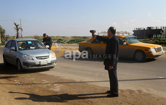 A Palestinian policeman uses for the first time a speed radar, in Gaza City, on Jan 03, 2011. The speed limit inside Gaza is 50 km/h.. Photo by Ashraf Amra