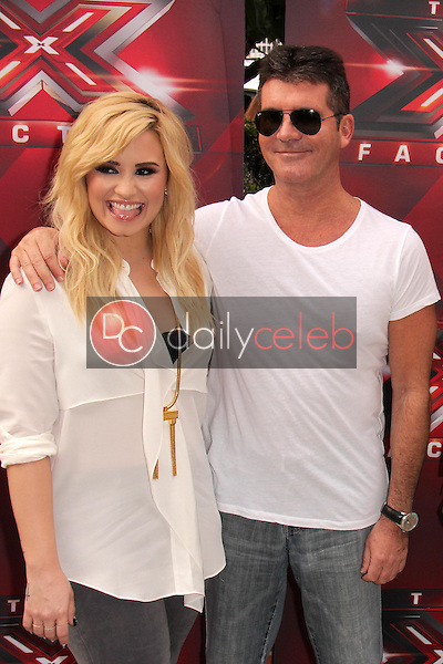 Demi Lovato, Simon Cowell<br /> at &quot;The X Factor&quot; Los Angeles Auditions, Galen Center, Los Angeles, CA 07-11-13<br /> David Edwards/DailyCeleb.Com 818-249-4998