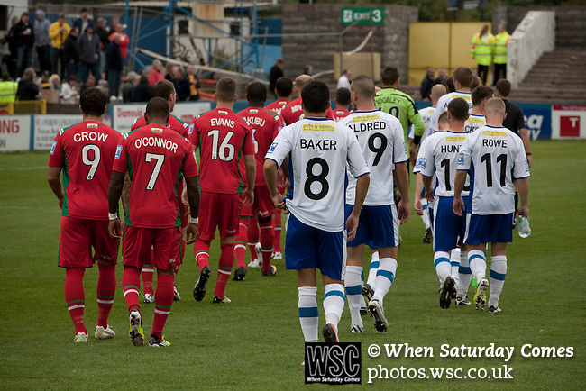 Barrow AFC 0 Newport County 3, 15/09/2012. Furness Building Society Stadium, Football Conference. The two teams walking on to the pitch at Barrow AFC's Furness Building Society Stadium prior to the delayed kick-off of the Barrow (white shirts) v Newport County Conference National Fixture. Newport County eventually won the match by 3-0, watched by 802 spectators. Both Barrow and Newport County from Wales were former members of the Football League in England. Photo by Colin McPherson.