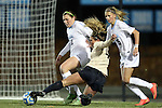 21 November 2014: Colorado's Madison Krauser (4) is defended by North Carolina's Jessie Scarpa (12) and Katie Bowen (NZL) (15). The University of North Carolina Tar Heels hosted the University of Colorado Buffaloes at Fetzer Field in Chapel Hill, NC in a 2014 NCAA Division I Women's Soccer Tournament Second Round match. UNC won the game 1-0 in overtime.