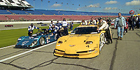 The #4 Corvette of Andy Pilgrim, Kelly Collins and Franck Freon and the #47 Spice Chevrolet SE90 of Richaed MacDill, Toss Vallancourt, John G. Thomas, Les Vallarano and  Ken Stiver lead the cars out to the grid for the Rolex 24 at Daytona, Daytona International Speedway, Daytona Beach, FL, February 2000.  (Photo by Brian Cleary/www.bcpix.com)