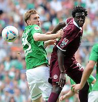 FUSSBALL   1. BUNDESLIGA   SAISON 2011/2012    1. SPIELTAG SV Werder Bremen - 1. FC Kaiserslautern             06.08.2011 Per MERTESACKER (li, Bremen) gegen RODNEI (re, Kaiserslautern)
