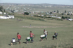 QUNU, SOUTH AFRICA - APRIL 2: Youth push wheelbarrows with water collected at a water source in the village of Qunu, where Nelson Mandela grew up on April 2, 2010, in Qunu, South Africa. Mr. Mandela was born in Mvezo, about 32 kilometers from here and Qunu and its surroundings is the area where he learned about life including his traditional manhood ceremony. Mr. Mandela was born in 1918, he served as a president of South Africa from 1994-1999, when he retired. Before that he was the leader of the armed wing of ANC and was convicted of sabotage among other crimes and served 27 years in prison, many of them on Robben Island, outside Cape Town. Qunu has a museum and Mr. Mandela has a big house where he and his family spends time while in the area. (Photo by Per-Anders Pettersson)