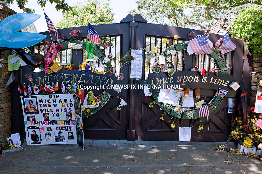 "MICHAEL JACKSON_The Farewell.As Michael Jackson is laid to rest, the gates and surroundings of his Neverland Ranch are covered with tributes and flags, Los Olivos, California_07/07/2009.Mandatory Photo Credit: ©Dias/Newspix International..**ALL FEES PAYABLE TO: ""NEWSPIX INTERNATIONAL""**..PHOTO CREDIT MANDATORY!!: NEWSPIX INTERNATIONAL(Failure to credit will incur a surcharge of 100% of reproduction fees)..IMMEDIATE CONFIRMATION OF USAGE REQUIRED:.Newspix International, 31 Chinnery Hill, Bishop's Stortford, ENGLAND CM23 3PS.Tel:+441279 324672  ; Fax: +441279656877.Mobile:  0777568 1153.e-mail: info@newspixinternational.co.uk"