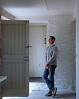 Dorian Bowen admiring the view from the stable doors of his converted cowshed in Wales