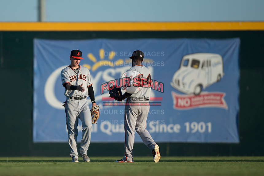 San Jose Giants outfielders Bryce Johnson (28) and Sandro Fabian (54) celebrate after a California League game against the Modesto Nuts at John Thurman Field on May 9, 2018 in Modesto, California. San Jose defeated Modesto 9-5. (Zachary Lucy/Four Seam Images)