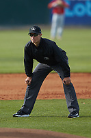 Umpire Dillon Wilson handles the calls on the bases during the South Atlantic League game between the Lakewood BlueClaws and the Kannapolis Intimidators at Kannapolis Intimidators Stadium on April 8, 2018 in Kannapolis, North Carolina.  The Intimidators defeated the BlueClaws 4-3 in game two of a double-header.  (Brian Westerholt/Four Seam Images)