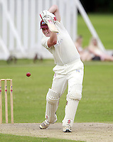 Jake Sharland bats for Highgate during the Middlesex County Cricket League Division Three game between Highgate and North London at Park Road, Crouch End on Sat July 12, 2014