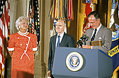 United States President George H.W. Bush and first lady Barbara Bush present the Presidential Medal of Freedom to National Security Advisor Brent Scowcroft during a ceremony in the East Room of the White House in Washington, DC on July 3, 1991. General Scowcroft is being honored for his efforts to ensure the success of Operation Desert Shield / Operation Desert Storm and the liberation of Kuwait.<br /> Credit: Ron Sachs / CNP