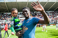 Bafetibi Gomis of Swansea City  on the pitch with team players and staff during a lap of honour after the Barclays Premier League match between Swansea City and Manchester City played at the Liberty Stadium, Swansea on the 15th of May  2016