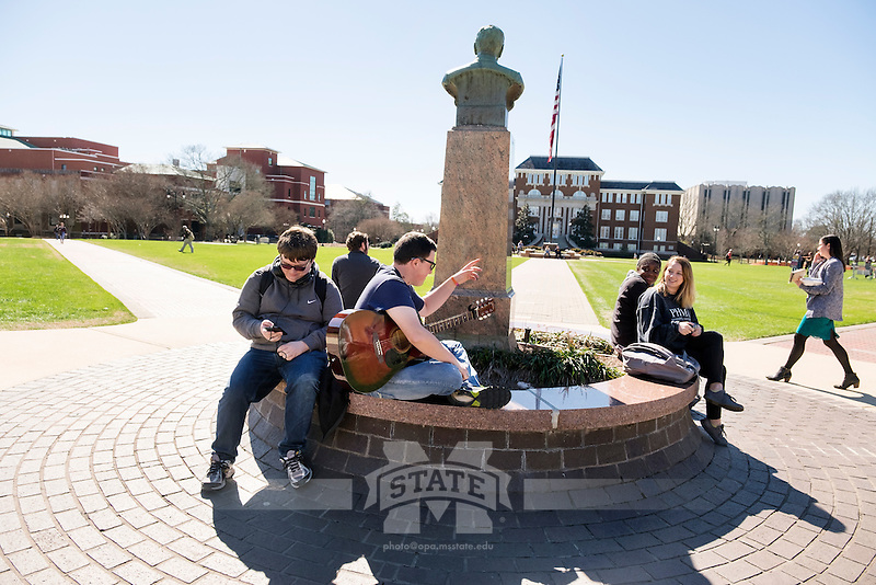 Damon Boyle (with guitar) talks with Phi Mu sisters Kirstin Hicks and Veronica Norman by the Drill Field Stephen D. Lee statue.<br />  (photo by Megan Bean / &copy; Mississippi State University)