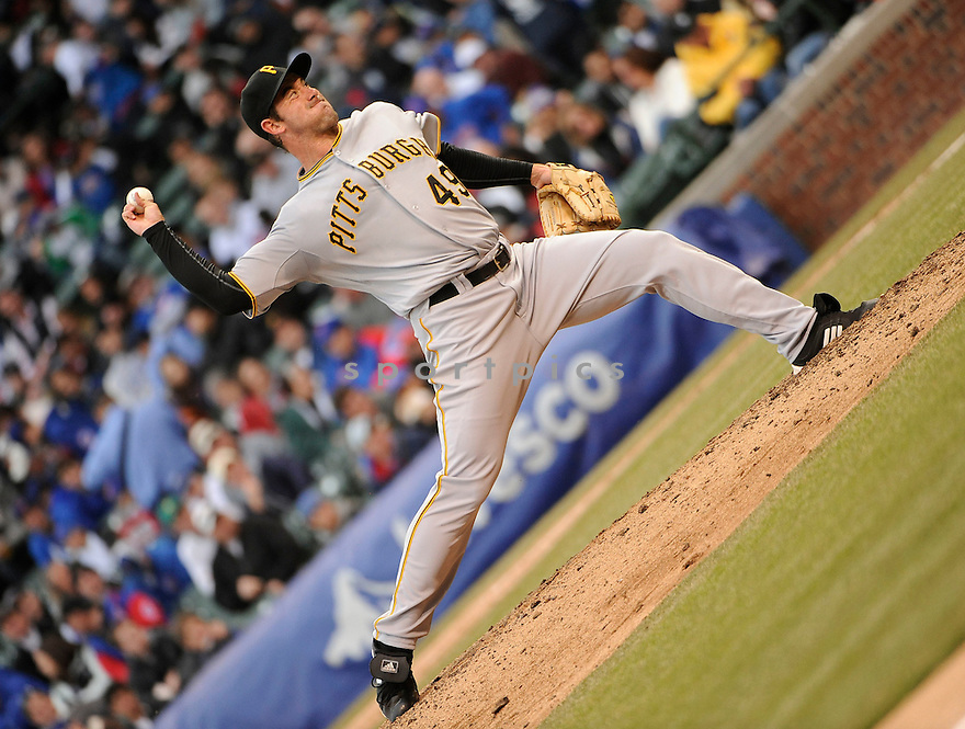 ROSS OHLENDORF, of the Pittsburgh Pirates, in actions during the Pirates game against the Chicago Cubs at Wrigley FIeld on April 3, 2011.  The Pirates won the game beating the Cubs 5-4.