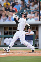 Andy Parrino (12) of the Charlotte Knights follows through on his swing against the Indianapolis Indians at BB&T BallPark on June 17, 2016 in Charlotte, North Carolina.  The Knights defeated the Indians 4-0.  (Brian Westerholt/Four Seam Images)