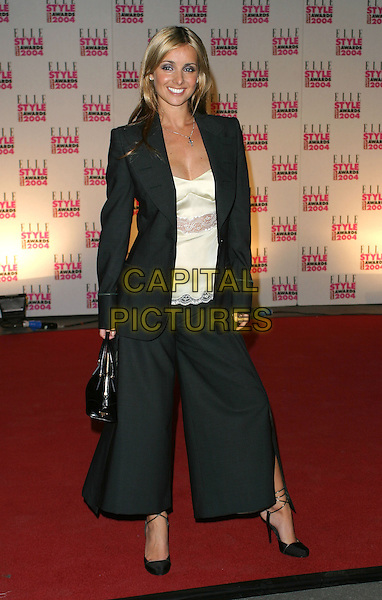 LOUISE REDKNAPP.Elle Style Awards at the Natural History Museum.16 February 2004.full length, full-length, black baggy trouser suit.www.capitalpictures.com.sales@capitalpictures.com.©Capital Pictures