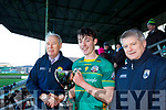 St Brendans Killarney captain Cian Gammell accepts the O'Sullivan Cup from Christy Kileen (left) and Weeshie Lynch of the Kerry Co Comm after winning the Coiste Iarbhunscoileanna Chiarrai GLC O'Sullivan Cup final in Austin Stack Park on Wednesday last