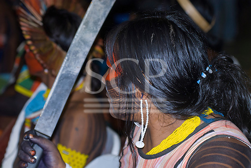 Altamira, Brazil. Encontro Xingu protest meeting about the proposed Belo Monte hydroeletric dam and other dams on the Xingu river and its tributaries. Tuira Kayapo holding a machete.
