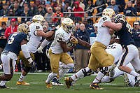 Notre Dame offensive lineman Mike McGlinchey blocks Pitt linebacker Matt Galambos (47) as Notre Dame running back CJ Prosise hits the hole. The Notre Dame Fighting Irish football team defeated the Pitt Panthers 42-30 on Saturday, November 7, 2015 at Heinz Field, Pittsburgh, Pennsylvania.