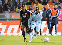 Sporting Kansas City forward C.J. Sapong (17) shields the ball against D.C. United defender Brandon McDonald (2).  Sporting Kansas City defeated D.C. United 1-0 at RFK Stadium,Saturday October 22, 2011.