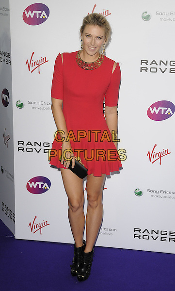 Maria Sharapova .attending the WTA Tour Pre-Wimbledon Party at The Roof Gardens, Kensington, London, England, UK, .16th June 2011.full length red dress  skater skirt black clutch bag gold cut out shoulders collar necklace  ankle boots .CAP/CAN.©Can Nguyen/Capital Pictures.
