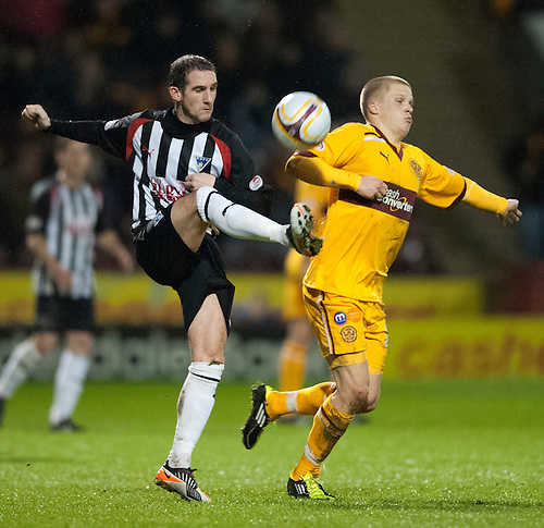 PICTURE BY - ROB CASEY .DESCRIPTION - MOTHERWELL v DUNFERMLINE.PIC SHOWS - MARK KERR AND HENRIK OJAMAA