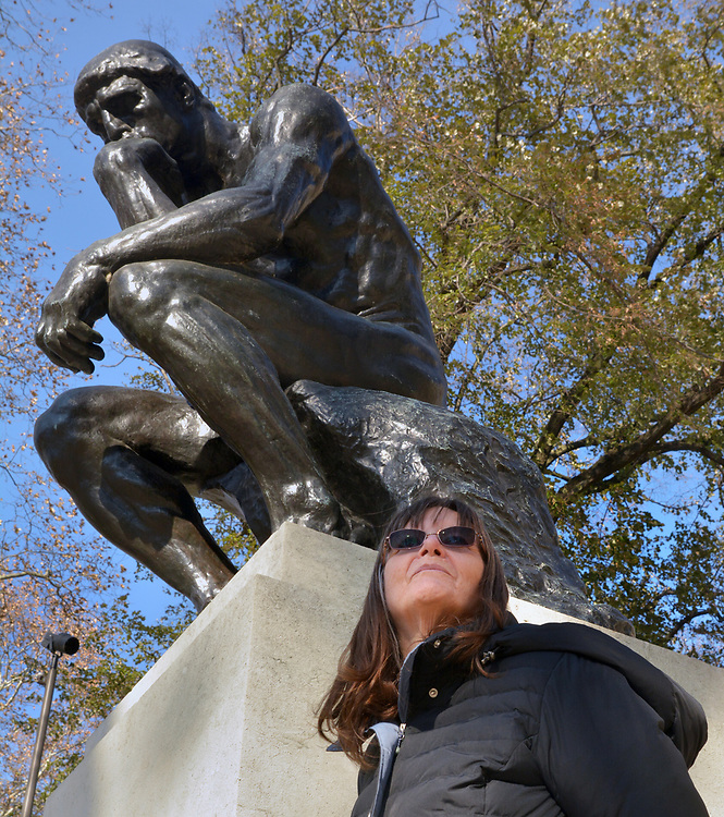 "Ginny Christensen posing near Original Bronze Sculpture titled, ""The Thinker"" by Auguste Rodin, in front of the Rodin Museum, on Benjamin Franklin Parkway, in Philadelphia, PA, on Monday, November 27, 2017. Photo by Jim Peppler. Copyright/Jim Peppler-2017."