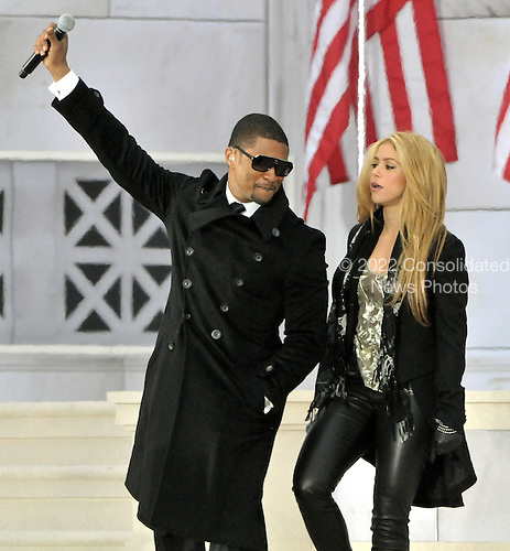 """Washington, DC - January 18, 2009 -- Usher, left, and Shakira, right, perform at the """"Today: We are One - The Obama Inaugural Celebration at the Lincoln Memorial"""" in Washington, D.C. on Sunday, January 18, 2009..Credit: Ron Sachs / CNP.(RESTRICTION: NO New York or New Jersey Newspapers or newspapers within a 75 mile radius of New York City)"""