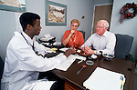 Mature couple in doctors office
