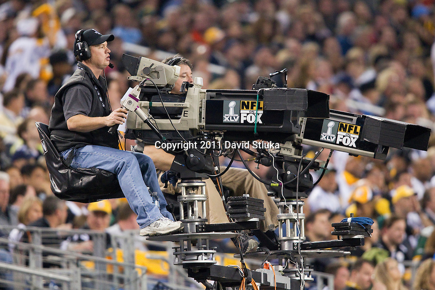 A sideline view of Fox Sports photographers on an elevated platform on the sideline during Super Bowl XLV where the Green Bay Packers played against the Pittsburgh Steelers on Sunday, February 6, 2011, in Arlington, Texas. The Packers won 31-25. (AP Photo/David Stluka)