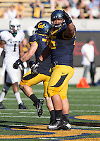 Saturday, September 7, 2013: Viliami Moala points towards to Cal fans during a game against Portland State at Memorial Stadium, Berkeley, California - California defeated Portland State 37 - 30