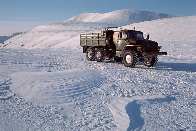 An Ural truck on a winter road in the Kolyma Mountains. Northern Evensk, Magadan Region, E. Siberia, Russia.