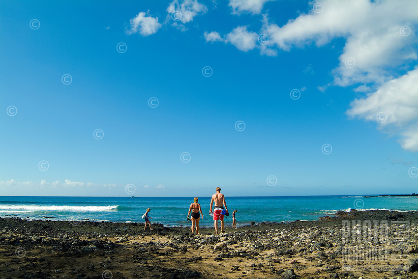 Tourists enjoy snorkeling in the shallow coral beds of La Perouse Bay on the Makena coast of West Maui.
