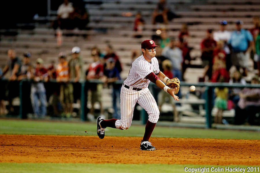 TALLAHASSEE, FL 5/7/11-FSU-UCFBASE11 CH-Florida State's Jayce Boyd tosses a grounder to first in the ninth inning against the University of Central Florida Saturday at Dick Howser Stadium in Tallahassee. The Seminoles lost to the Knights 10-14..COLIN HACKLEY PHOTO