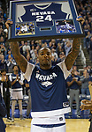 Nevada's Jordan Caroline (24) holds up his framed jersey on during senior night before an NCAA college basketball game against San Diego State in Reno, Nev., Saturday, March 9, 2019. (AP Photo/Tom R. Smedes)