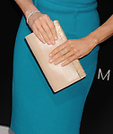 WESTWOOD, CA- AUGUST 07: Actress Jodie Foster (handbag, jewelry detail) at the Los Angeles premiere of 'Elysium' at Regency Village Theatre on August 7, 2013 in Westwood, California.