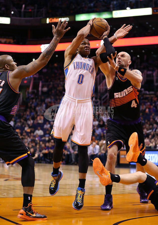 Feb. 10, 2013; Phoenix, AZ, USA: Oklahoma City Thunder point guard Russell Westbrook (0) drives to the basket against Phoenix Suns center Marcin Gortat (4) at the US Airways Center. Mandatory Credit: Mark J. Rebilas-
