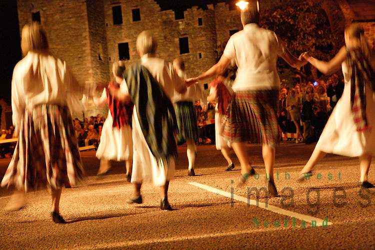 Kirkcudbright Tattoo Scotland UK At dusk traditional country dancing dancers in kilts with MacLellans Castle as backdrop