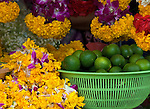 Marigolds and Limes - Plastic basket of limes with marigold and orchid flowers