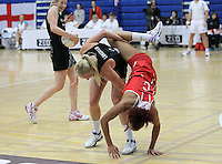 20.1.2014 New Zealand's Laura Lagman competes off the ball with England's Serena Guthrie during their netball test match in London, England. Mandatory Photo Credit (Pic: David Klein). ©Michael Bradley Photography.