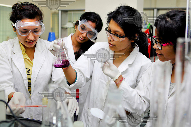 Students study during a chemistry experiment in a laboratory at the Asian University for Women. /Felix Features