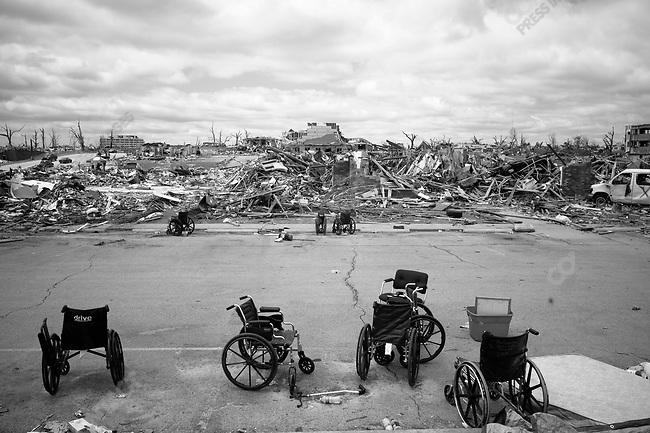 Abandoned wheelchairs are scattered in the parking lot at the devastated Greenbriar Nursing Home in Joplin, Mo. Wednesday, May 26, 2011. .Eleven residents died after an EF-5 tornado struck the facility...