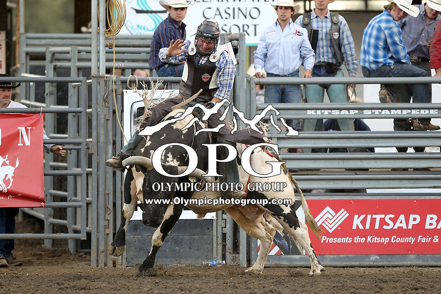 21 Aug 2013:  Allen Helmuth riding the bull Cowboy Delux scored a 80 in the first round of competition of the Extreme Bulls Wednesday at the Kitsap County Fair and Stampede Rodeo in Bremerton, Washington.