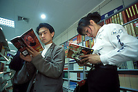 People read books about the life of Deng Xiaoping at a bookstore in China.