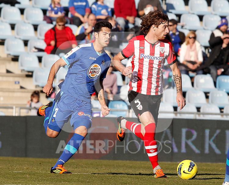 Getafe's Miku against Athletic de Bilbao's Fernando Amorebieta during La Liga Match. January 08, 2012. (ALTERPHOTOS/Alvaro Hernandez)