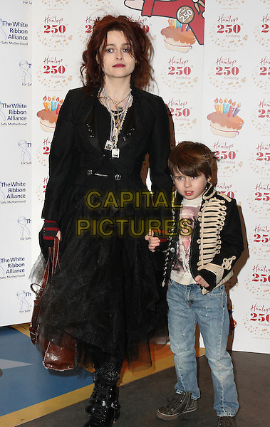 HELENA BONHAM CARTER & BILLY RAYMOND BURTON.Attending Hamleys 250th Birthday Party at Hamleys Toy Store, Regent Street, London, England, UK,.February 11th 2010..arrivals full length child family kid mother mum mom black victorian victoriana skirt boots jacket bag holding hands jeans necklace striped red gloves military tulle .CAP/JIL.©Jill Mayhew/Capital Pictures