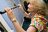 Women using lat pulldown equipment in a YMCA gym,