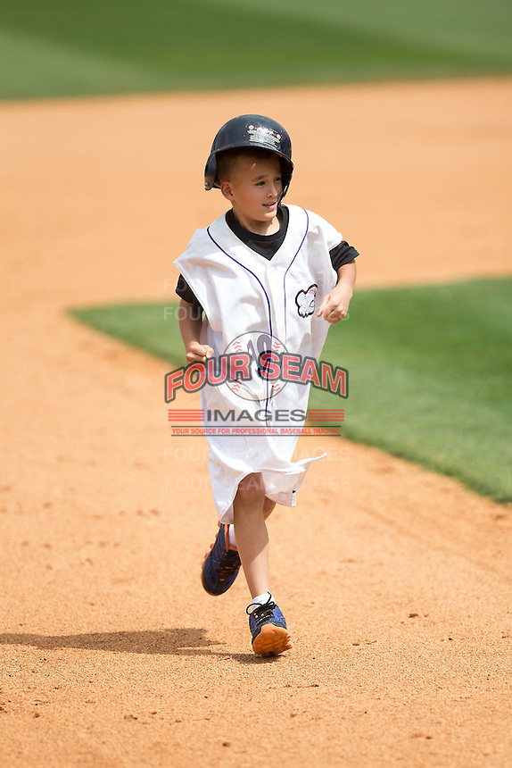 A young fan competes in a between innings race during the Carolina League game between the Myrtle Beach Pelicans and the Winston-Salem Dash at BB&T Ballpark on May 10, 2015 in Winston-Salem, North Carolina.  The Pelicans defeated the Dash 4-3.  (Brian Westerholt/Four Seam Images)