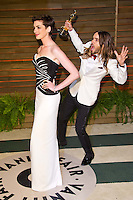 Anne Hathaway 'photobombed' by Jared Leto arriving for the 2014 Vanity Fair Oscars Party, Los Angeles. 02/03/2014 Picture by: James McCauley/Featureflash
