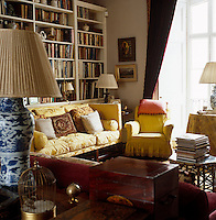 A bookcase stretches the length of one of the living room walls